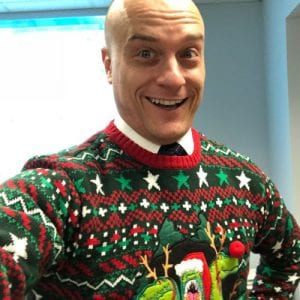 Adam Radulovic wearing a christmas sweater