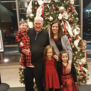 Dave and his family in front of Christmas tree