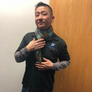 John Kim wearing an XL net polo and scarf